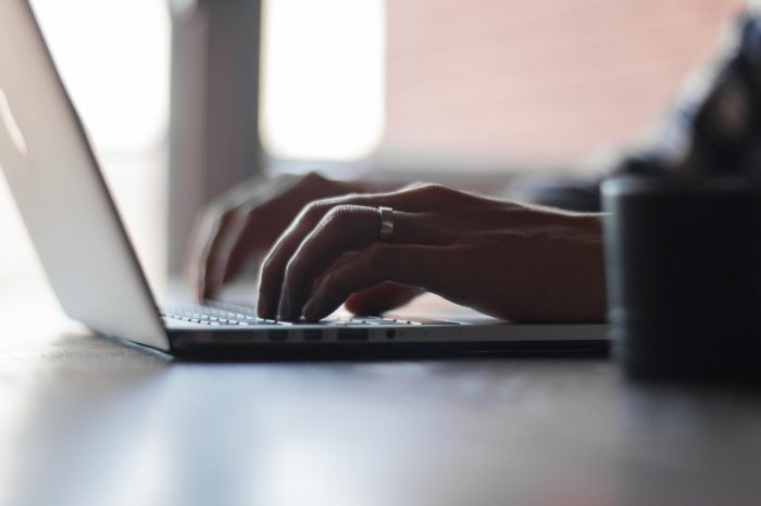 Small business owner writes a blog post